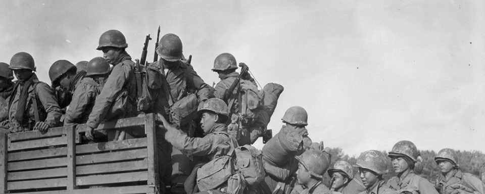 Japanese-American troops climb into a truck as they prepare to move their bivouac area. 2nd Battalion, 442nd Combat Team, Chambois Sector. France. 10/14/44. Courtesy of the Seattle Nisei Veterans Committee and the U.S. Army