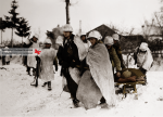 Those men are probably part of the A Company, 509th Parachute Infantry Battalion and are moving their wounded by sled. This picture was taken in Born, in January 1945. Like all units involved in the Battle of the Bulge, living conditions are dramatic. There will remain only 55 men in the battalion at the end of the battle.