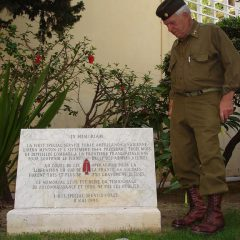 Sam next to the monument of the FSSF in Menton, on the french-italian border. (Gilles Guignard)